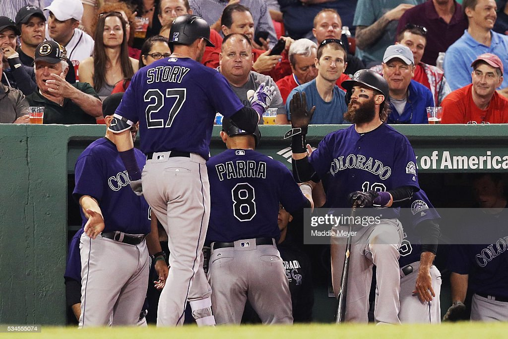 <a gi-track='captionPersonalityLinkClicked' href=/galleries/search?phrase=Charlie+Blackmon&family=editorial&specificpeople=7519880 ng-click='$event.stopPropagation()'>Charlie Blackmon</a> #19 of the Colorado Rockies congratulates <a gi-track='captionPersonalityLinkClicked' href=/galleries/search?phrase=Trevor+Story&family=editorial&specificpeople=13669220 ng-click='$event.stopPropagation()'>Trevor Story</a> #27 after he hit a two run homer against the Boston Red Sox during the fifth inning at Fenway Park on May 26, 2016 in Boston, Massachusetts.