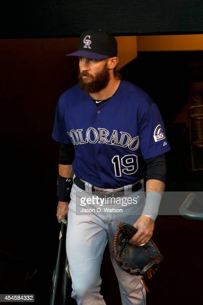 Charlie Blackmon of the Colorado Rockies enters the dugout before the game against the San Francisco Giants at ATT Park on August 25 2014 in San...