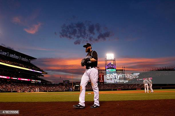 Charlie Blackmon of the Colorado Rockies heads to the dugout between innings against the Arizona Diamondbacks as the sun sets at Coors Field on June...