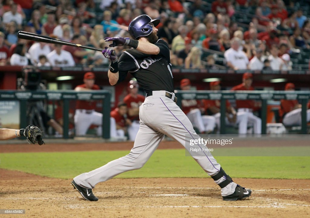 Charlie Blackmon #19 of the Colorado Rockies hits a deep fly ball against the Arizona Diamondbacks during the fourth inning of a MLB game at Chase Field on August 31, 2014 in Phoenix, Arizona.