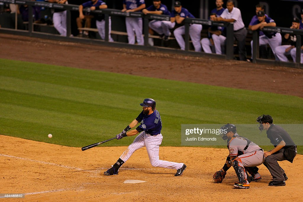 <a gi-track='captionPersonalityLinkClicked' href=/galleries/search?phrase=Charlie+Blackmon&family=editorial&specificpeople=7519880 ng-click='$event.stopPropagation()'>Charlie Blackmon</a> #19 of the Colorado Rockies hits a game winning RBI single during the ninth inning as catcher Quiroz Guillermo #14 of the San Francisco Giants and home plate umpire John Tumpane look on at Coors Field on September 1, 2014 in Denver, Colorado. The Rockies defeated the Giants 10-9.