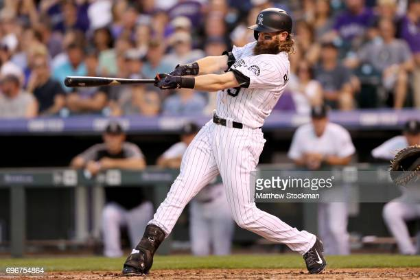 Charlie Blackmon of the Colorado Rockies hits a RBI triple in the fifth inning against the San Francisco Giants at Coors Field on June 16 2017 in...
