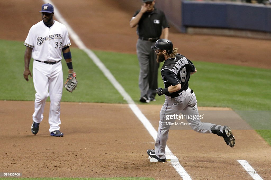 Charlie Blackmon of the Colorado Rockies hits a single during the third inning against the Milwaukee Brewers at Miller Park on August 23 2016 in...