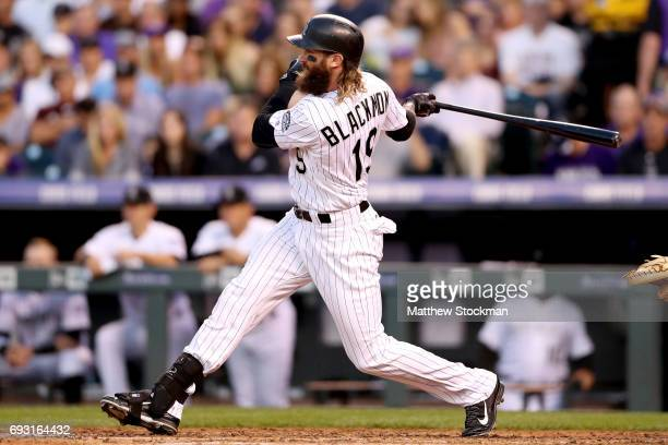 Charlie Blackmon of the Colorado Rockies hits a single in the fifth inning against the Cleveland Indians at Coors Field on June 6 2017 in Denver...