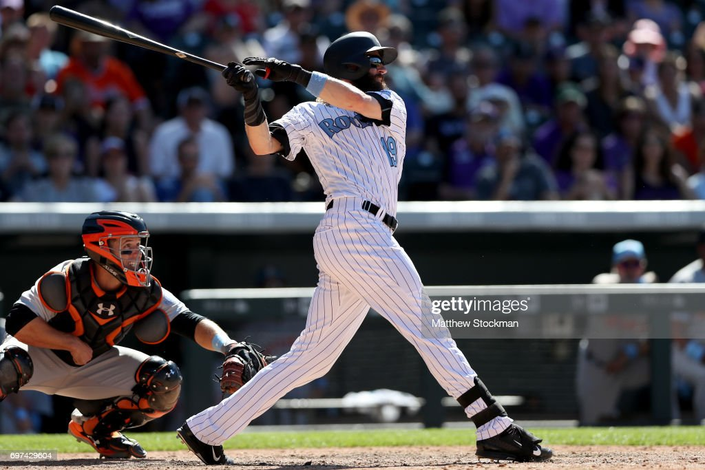 Charlie Blackmon #19 of the Colorado Rockies hits a single in the ninth inning against the San Francisco Giants at Coors Field on June 18, 2017 in Denver, Colorado.