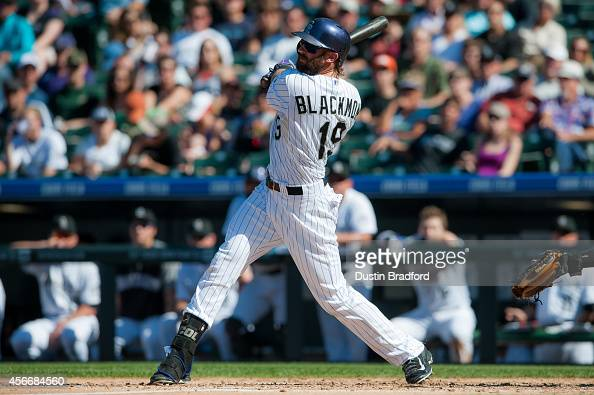 Charlie Blackmon of the Colorado Rockies hits a triple against the Arizona Diamondbacks during a game at Coors Field on September 20 2014 in Denver...