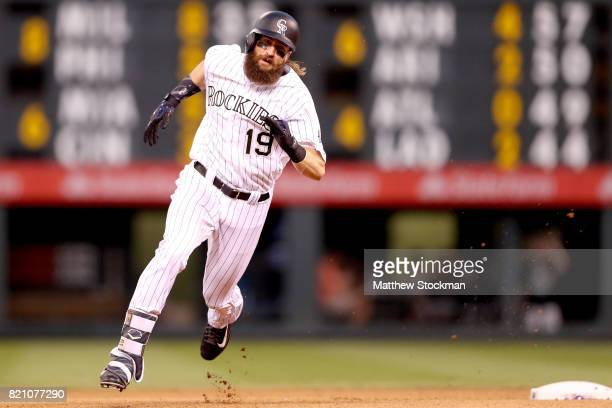 Charlie Blackmon of the Colorado Rockies hits a triple in the seventh inning against the Pittsburgh Pirates at Coors Field on July 22 2017 in Denver...