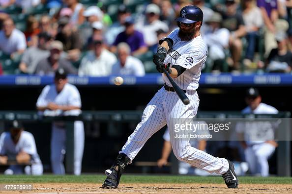 Charlie Blackmon of the Colorado Rockies hits a tworun home run during the fifth inning against the Milwaukee Brewers at Coors Field on June 20 2015...