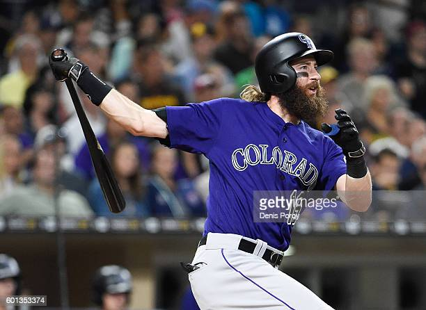 Charlie Blackmon of the Colorado Rockies hits a tworun home run during the third inning of a baseball game against the San Diego Padres at PETCO Park...