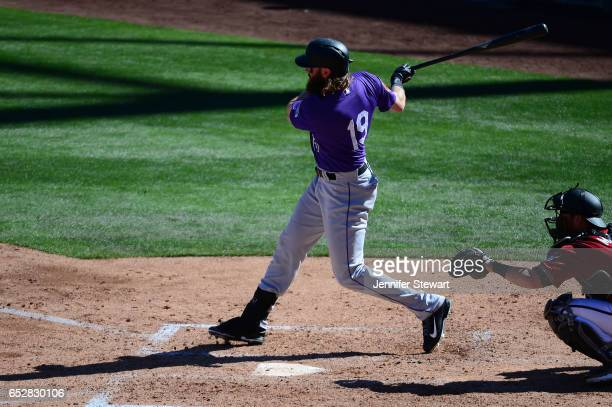 Charlie Blackmon of the Colorado Rockies hits the ball against the Arizona Diamondbacks during the spring training game at Salt River Fields at...
