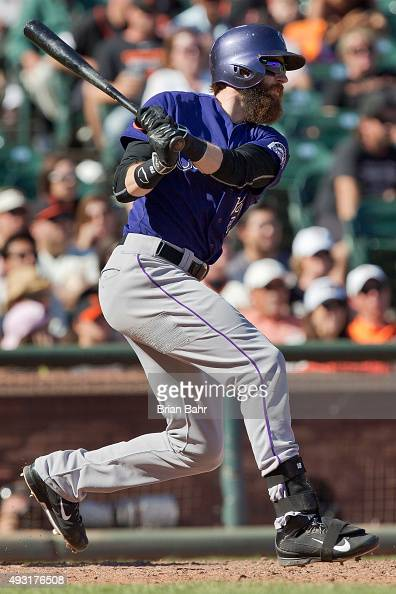 Charlie Blackmon of the Colorado Rockies hits to center for a tworun single against the San Francisco Giants in the ninth inning at ATT Park on...