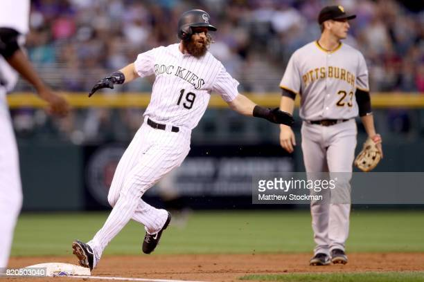 Charlie Blackmon of the Colorado Rockies holds on thrid base on a DJ LeMahieu double in the first inning against the Pitsburgh Pirates at Coors Field...