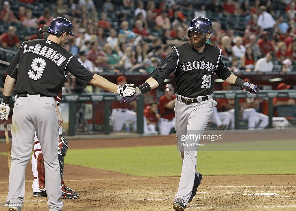 <a gi-track='captionPersonalityLinkClicked' href=/galleries/search?phrase=Charlie+Blackmon&family=editorial&specificpeople=7519880 ng-click='$event.stopPropagation()'>Charlie Blackmon</a> #19 of the Colorado Rockies is congratulated after crossing the plate by teammate D.J. LeMahieu #9 after his solo home run against the Arizona Diamondbacks during the fourth inning of a MLB game at Chase Field on August 31, 2014 in Phoenix, Arizona.