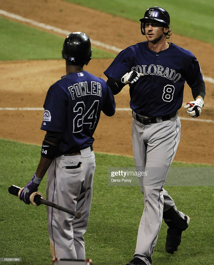 Charlie Blackmon #8 of the Colorado Rockies is congratulated by <a gi-track='captionPersonalityLinkClicked' href=/galleries/search?phrase=Dexter+Fowler&family=editorial&specificpeople=4949024 ng-click='$event.stopPropagation()'>Dexter Fowler</a> #24 after hitting a solo home run during the eighth inning of a baseball game against the San Diego Padres at Petco Park on September 14, 2012 in San Diego, California. The Rockies won 7-4.