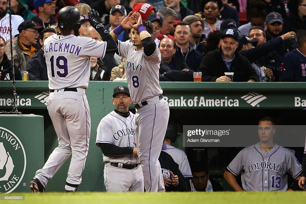 <a gi-track='captionPersonalityLinkClicked' href=/galleries/search?phrase=Charlie+Blackmon&family=editorial&specificpeople=7519880 ng-click='$event.stopPropagation()'>Charlie Blackmon</a> #19 of the Colorado Rockies is congratulated by <a gi-track='captionPersonalityLinkClicked' href=/galleries/search?phrase=Gerardo+Parra&family=editorial&specificpeople=4959447 ng-click='$event.stopPropagation()'>Gerardo Parra</a> #8 at the dugout after his a home run in the third inning during the game against the Boston Red Sox at Fenway Park on May 24, 2016 in Boston, Massachusetts.