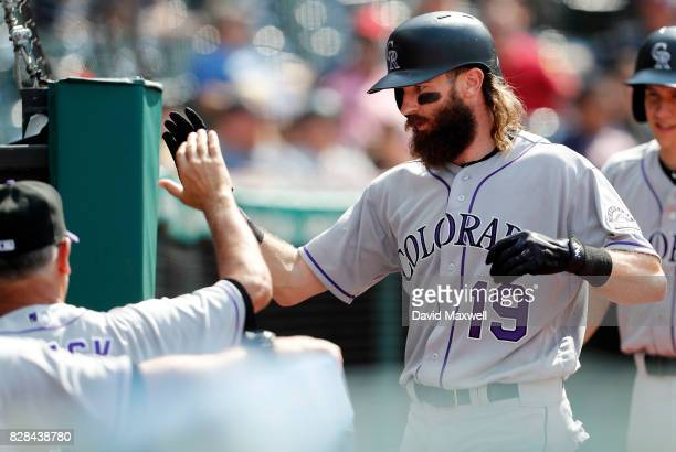 Charlie Blackmon of the Colorado Rockies is congratulated by Manager Bud Black as he returns to the dugout after hitting the game winning home run...