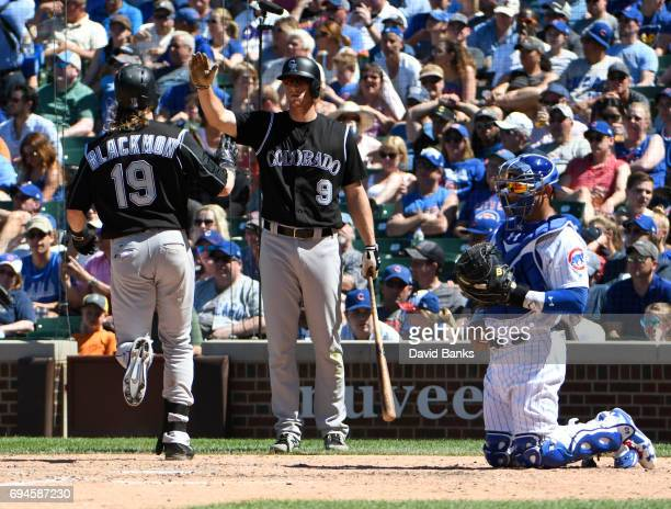 Charlie Blackmon of the Colorado Rockies is greeted by DJ LeMahieu after hitting a home run against the Chicago Cubs during the seventh inning on...