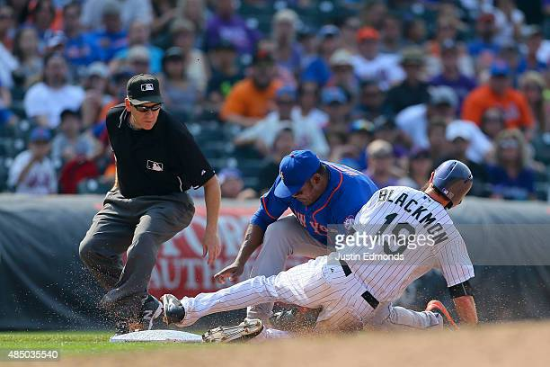 Charlie Blackmon of the Colorado Rockies is tagged out by third baseman Juan Uribe of the New York Mets for the third out of the sixth inning as...