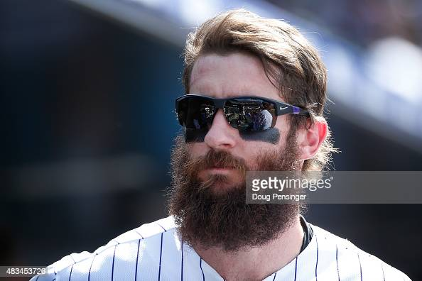 Charlie Blackmon of the Colorado Rockies looks on from the dugout against the Seattle Mariners during interleague play at Coors Field on August 5...