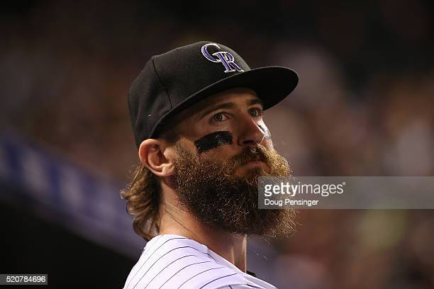 Charlie Blackmon of the Colorado Rockies looks on from the dugout against the San Francisco Giants at Coors Field on April 12 2016 in Denver Colorado...