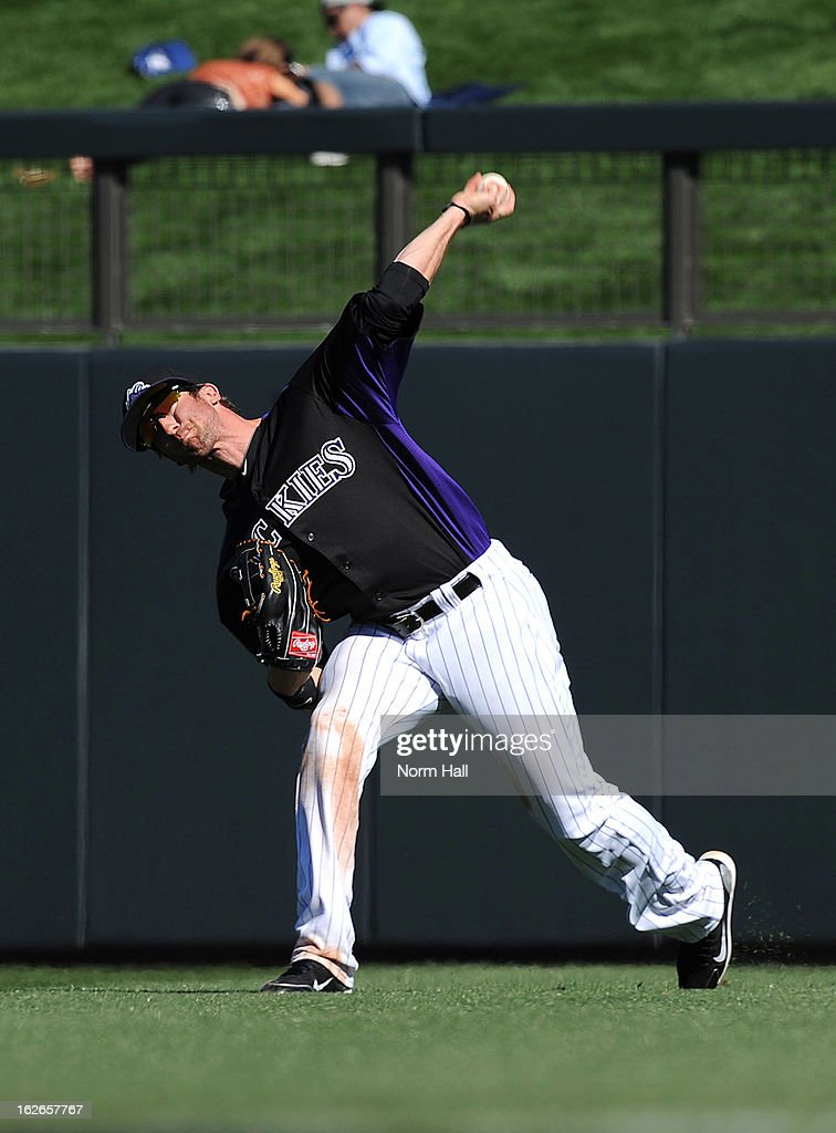 Charlie Blackmon #19 of the Colorado Rockies makes a throw from right field against the Texas Rangers at Salt River Field on February 25, 2013 in Scottsdale, Arizona.