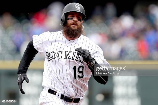 Charlie Blackmon of the Colorado Rockies races to third base after hitting a triple in the third inning against the Arizona Diamondbacks at Coors...