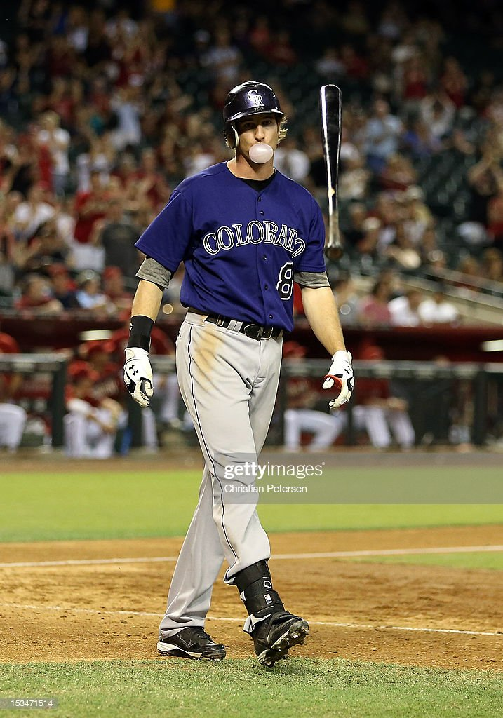 Charlie Blackmon #8 of the Colorado Rockies reacts after striking out against the Arizona Diamondbacks during the MLB game at Chase Field on October 3, 2012 in Phoenix, Arizona.
