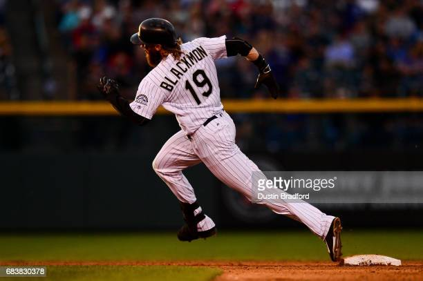 Charlie Blackmon of the Colorado Rockies rounds second base on his way to a third inning triple against the Los Angeles Dodgers at Coors Field on May...