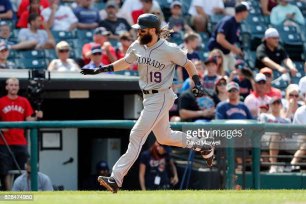 Charlie Blackmon of the Colorado Rockies rounds the bases after hitting the gamewinning home run against the Cleveland Indians in the 12th inning at...