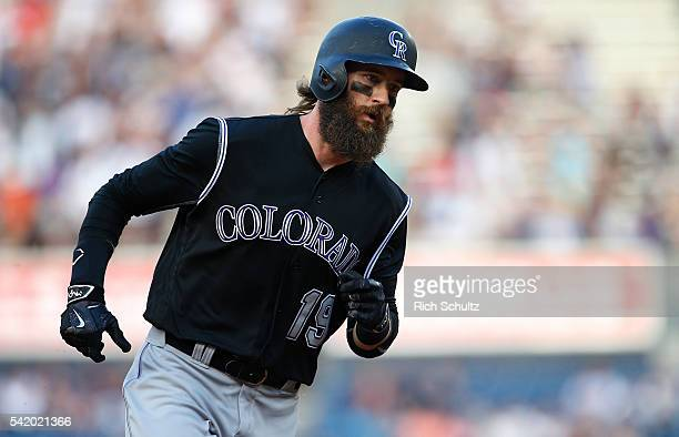 Charlie Blackmon of the Colorado Rockies rounds third base after hitting a home run in the first inning against the New York Yankees during a game at...