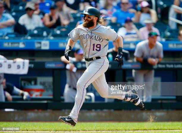 Charlie Blackmon of the Colorado Rockies runs for home during his seventh inning two run inside the park home run against the New York Mets on July...