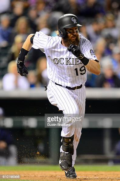 Charlie Blackmon of the Colorado Rockies runs out a seventh inning leadoff double against the San Diego Padres during a game at Coors Field on...