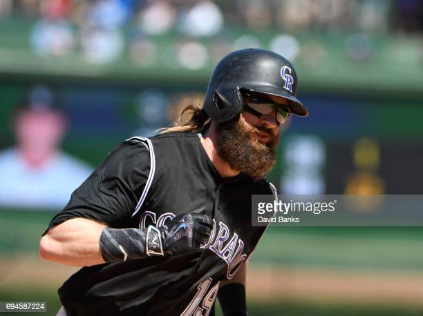 Charlie Blackmon of the Colorado Rockies runs the bases after hitting a home run against the Chicago Cubs during the seventh inning on June 10 2017...