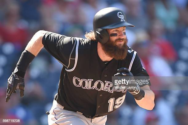 Charlie Blackmon of the Colorado Rockies runs to first base during a baseball game against the Washington Nationals at Nationals Park on August 27...