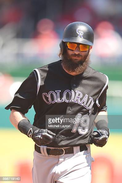Charlie Blackmon of the Colorado Rockies runs to third base during a baseball game against the Washington Nationals at Nationals Park on August 27...