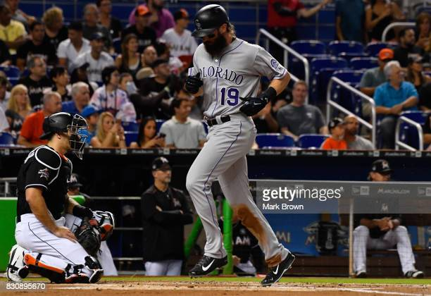 Charlie Blackmon of the Colorado Rockies scores in the first inning during the game between the Miami Marlins and the Colorado Rockies at Marlins...