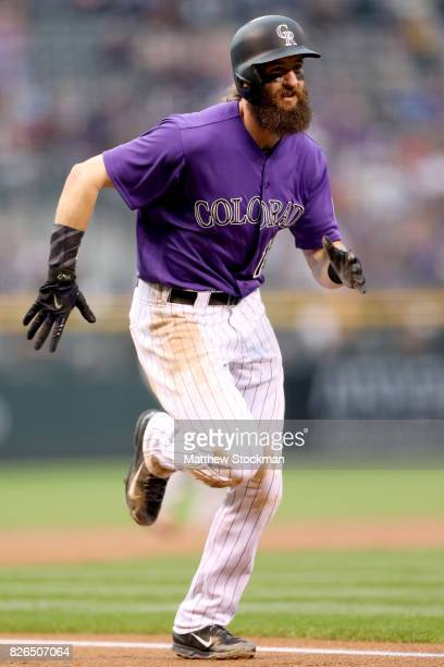 Charlie Blackmon of the Colorado Rockies scores on a Carlos Gonzalez 2 RBI single in the first inning against the Philadelphia Phillies at Coors...