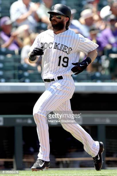 Charlie Blackmon of the Colorado Rockies scores on a Nolan Arenado RBI single in the first inning against the San Diego Padres at Coors Field on July...