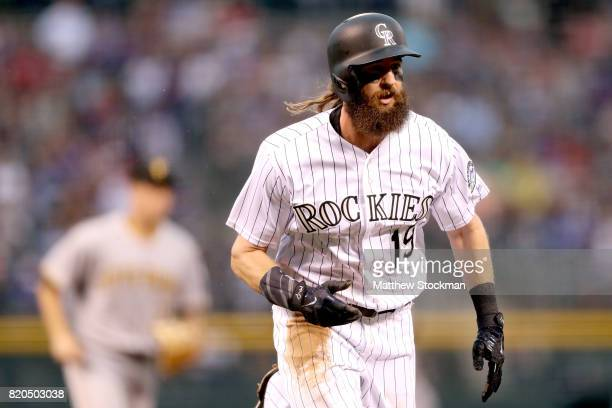 Charlie Blackmon of the Colorado Rockies scores on a Nolan Arenado single in the first inning against the Pitsburgh Pirates at Coors Field on July 21...