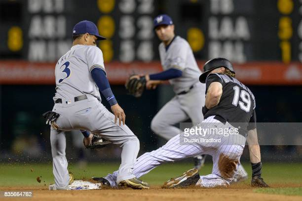 Charlie Blackmon of the Colorado Rockies slides safely into second base ahead of a tag by Orlando Arcia of the Milwaukee Brewers in the seventh...