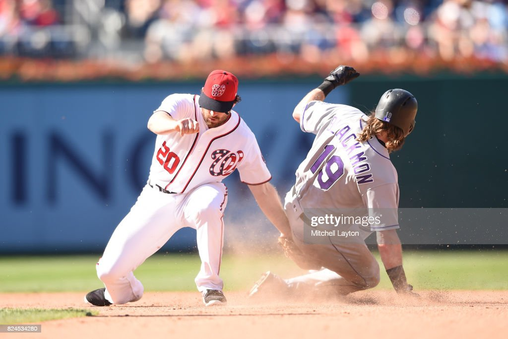 Charlie Blackmon #19 of the Colorado Rockies steals second base on throw to Daniel Murphy #20 of the Washington Nationals in the eight inning during game one of a doubleheader baseball game at Nationals Park on July 30, 2017 in Washington, DC.
