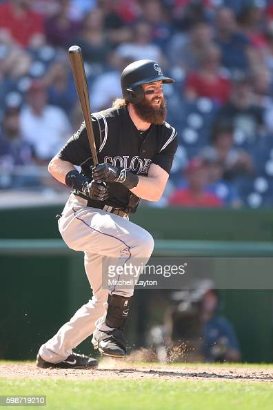 Charlie Blackmon of the Colorado Rockies takes a swing during a baseball game against the Washington Nationals at Nationals Park on August 27 2016 in...