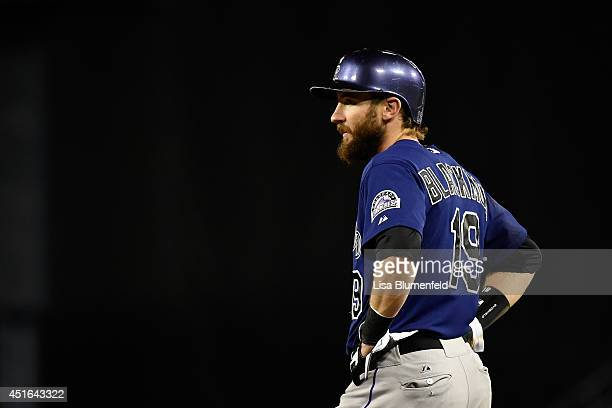 Charlie Blackmon of the Colorado Rockies waits at first base after hitting a single against the Los Angeles Dodgers at Dodger Stadium on June 17 2014...
