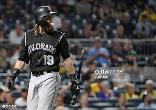 Charlie Blackmon of the Colorado Rockies walks back to the dugout after striking out in the ninth inning during the game against the Pittsburgh...