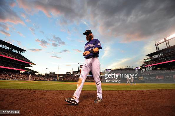 Charlie Blackmon of the Colorado Rockies walks off the field in the sixth inning against the Tampa Bay Rays at Coors Field on July 18 2016 in Denver...