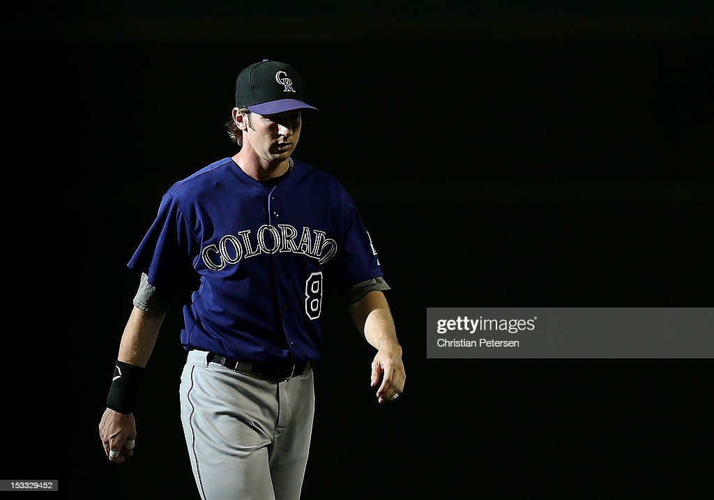 Charlie Blackmon #8 of the Colorado Rockies walks on the field before the MLB game against the Arizona Diamondbacks at Chase Field on October 3, 2012 in Phoenix, Arizona.