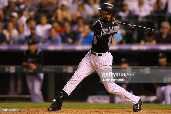 Charlie Blackmon of the Colorado Rockies watches his RBI single during the eighth inning against the Arizona Diamondbacks at Coors Field on June 23...