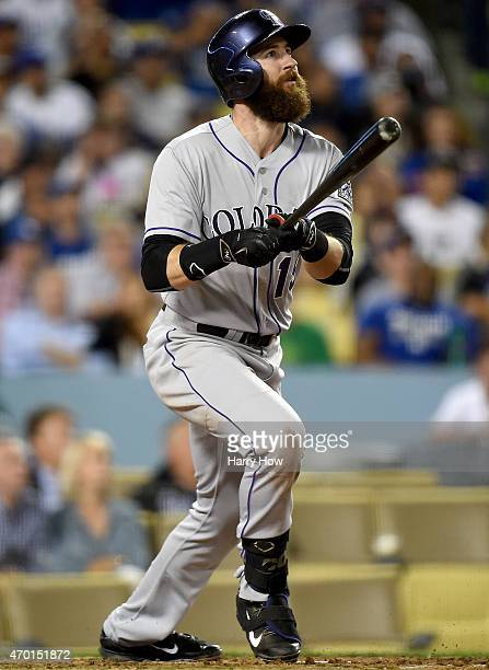 Charlie Blackmon of the Colorado Rockies watches his two run homerun to trail 43 to the Los Angeles Dodgers during the fifth inning at Dodger Stadium...