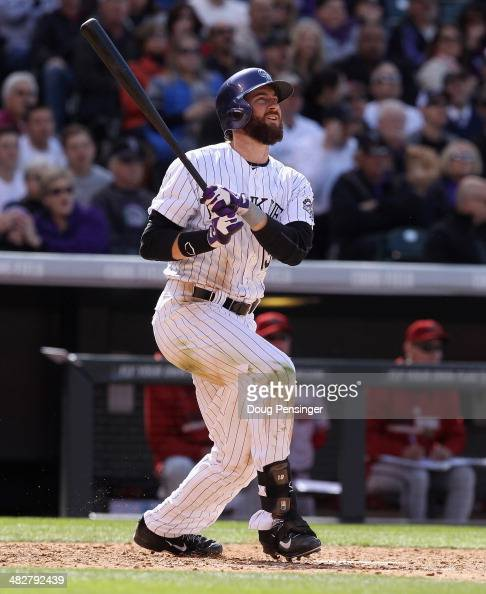 Charlie Blackmon of the Colorado Rockies watches his two run homerun off of Randall Delgado of the Arizona Diamondbacks to give the Rockies a 60 lead...