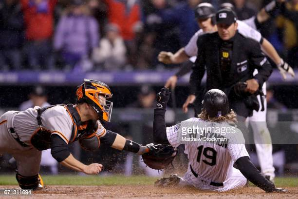 Charlie Blackmon of the Colorado Rockiesbeats the tag of catcher Buster Posey of the San Francisco Giants for a 2 run inside the park home run in the...
